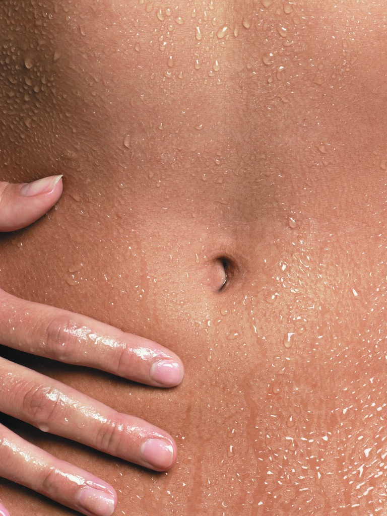 Young Woman's Belly --- Image by © Sonja Pacho/Corbis